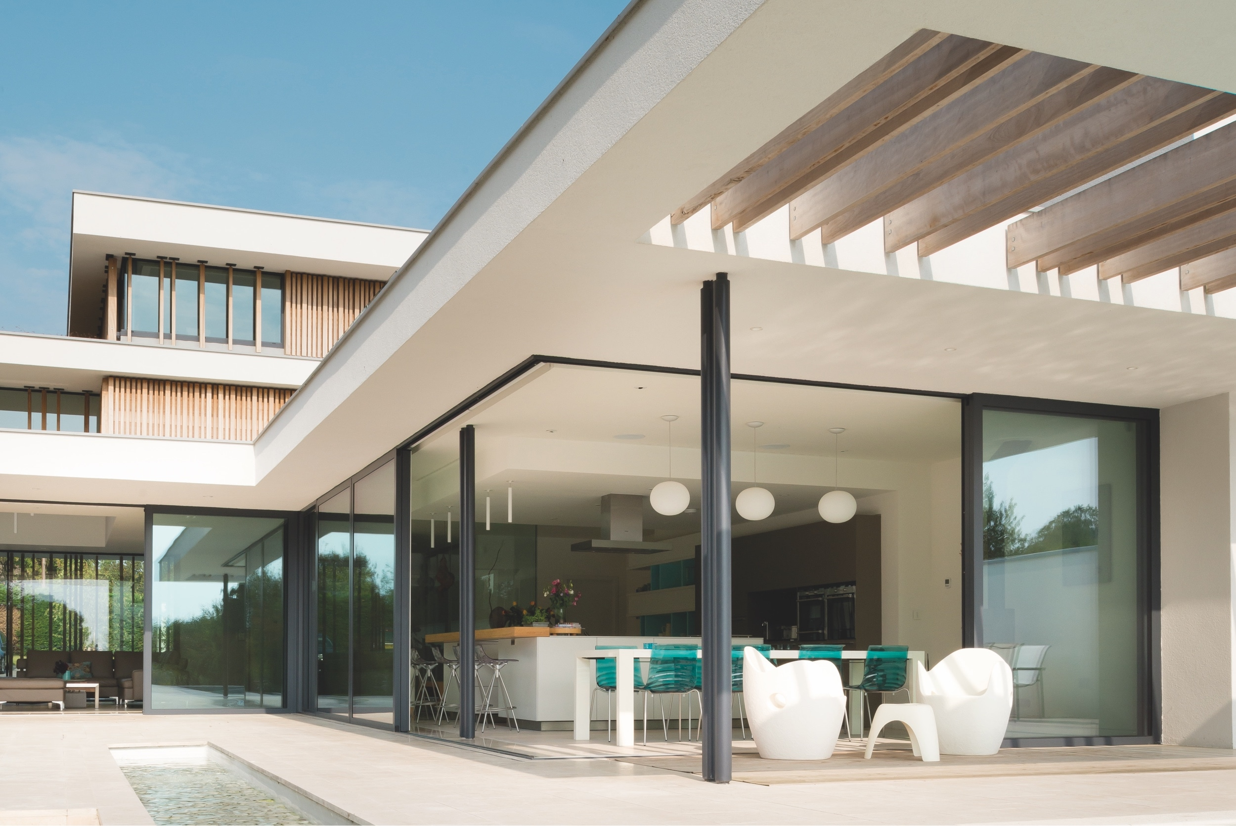 Modern architecture featuring the IDSystems Grand Slider II sliding doors
